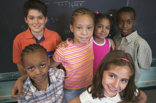 Kids standing together in a classroom